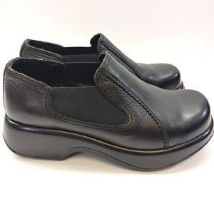 NWOT Dansko black leather elastic slip-on Clogs